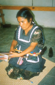 Crispina Navarro, WBB artist weaving at her studio